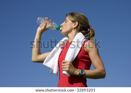 Young sporty women drinking water - stock photo