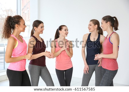 Young sporty women talking at training