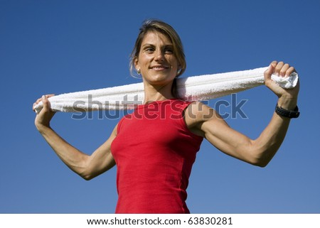 Young sporty women with a white towel - stock photo