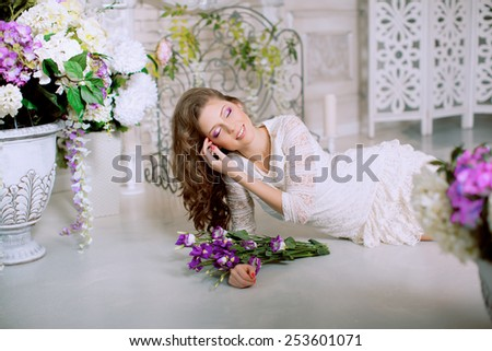 Young spring fashion woman in spring lux vintage interior. Springtime. Trendy girl on a luxury spring background. Allergic to pollen of flowers. Spring allergy  - stock photo