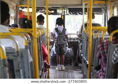 Young sri lankan girl going to school by bus - stock photo