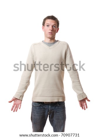 Young standing man with confused expression isolated on white background - stock photo