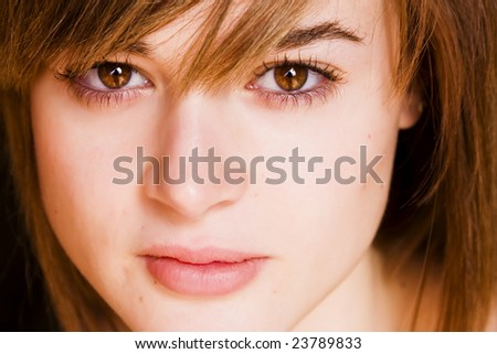 Young staring woman close portrait