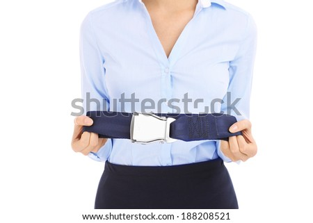 Young stewardess in blue shirt showing belt over white - stock photo