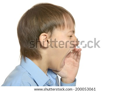 Young stressed boy scream on white background