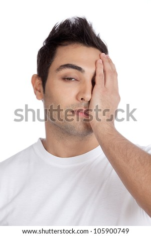 Young stressed man with hand on his face isolated on white background. - stock photo