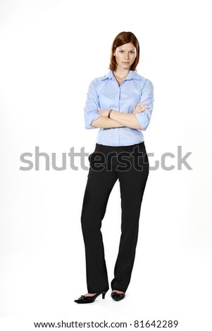 Young strict businesswoman isolated on a white background standing in a defensive position - stock photo