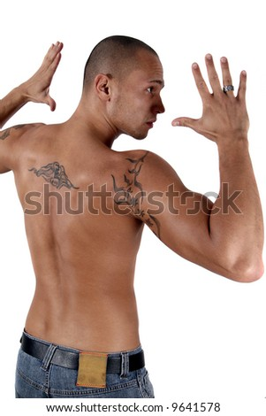 Young, Strong And Healthy Young man showing his muscles and his tattooed back - isolated over white! - stock photo