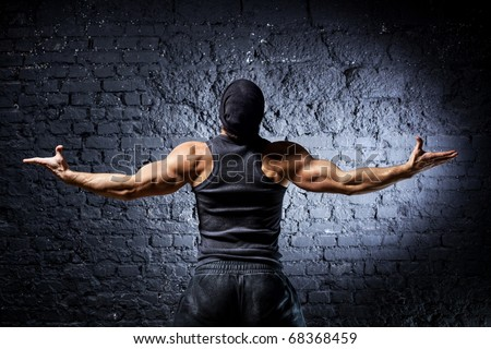 Young strong man backside view. - stock photo