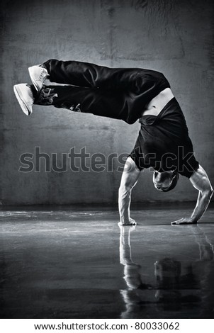 Young strong man break dance. Black and white. - stock photo