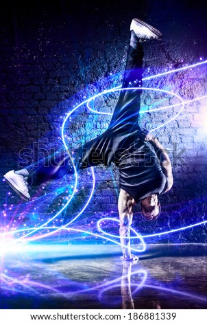 Young strong man break dance. With light effects. - stock photo