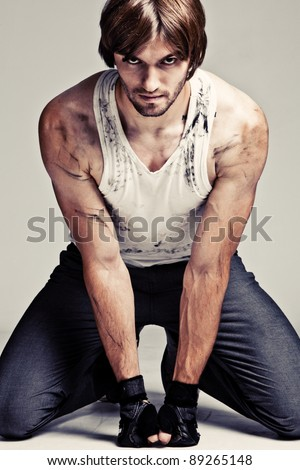 young strong man in staind tanktop - stock photo
