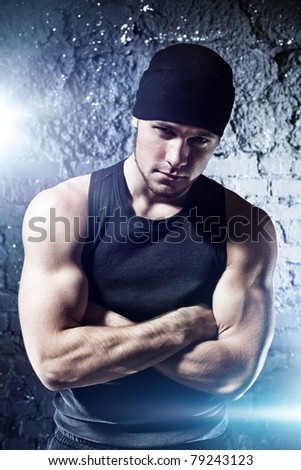 Young strong man portrait. With flash effect. - stock photo