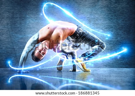 Young strong man. With iron hands and light effects. - stock photo