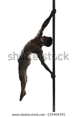 Young strong pole dance man isolated over white background
