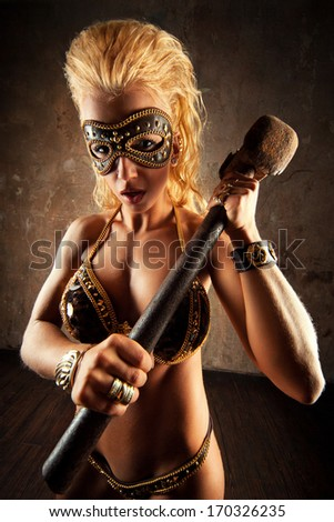 Young strong woman with hammer. - stock photo