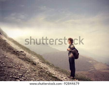Young student about to climb a hill - stock photo