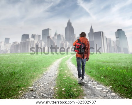Young student approaching a big city - stock photo