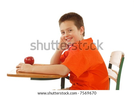 Young student at his desk, with a book and apple, ready to learn - stock photo
