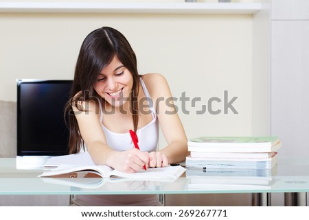Young student at home - stock photo
