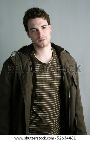 young student autumn winter fashion portrait gray grunge background - stock photo
