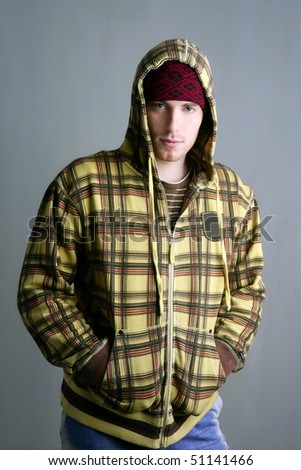 young student boy with red cap and yellow jacket on gray grunge background - stock photo
