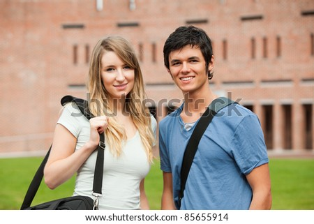 Young student couple posing outside a building