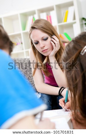 Young student girl learning with her friends - stock photo