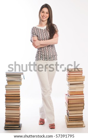 Young student girl with her books on white - stock photo