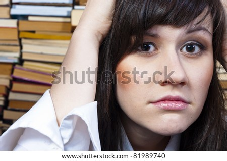 Young student girl with worried expression on her face - stock photo