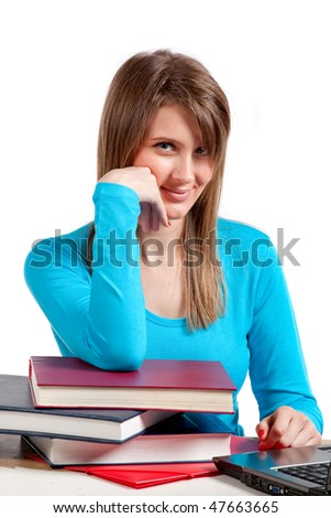 young student girl working on her laptop computer - stock photo