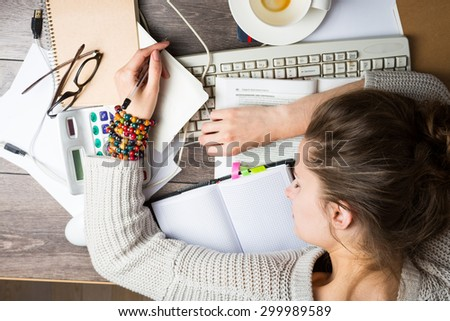 Young student graduate school overnight preparing for the exam. Top view.  Fatigue fell asleep at the table - stock photo