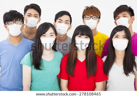 young student group wearing a mask - stock photo