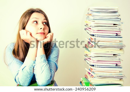 Young student have a lot of work to do. Education conceptual image. - stock photo