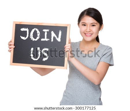 Young student hold with black board showing phrase join us - stock photo