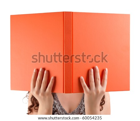 Young student holding book in front of her face. - stock photo