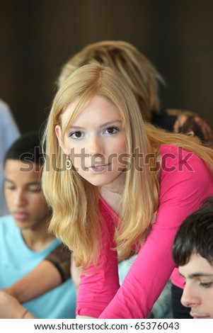 Young student in classroom - stock photo