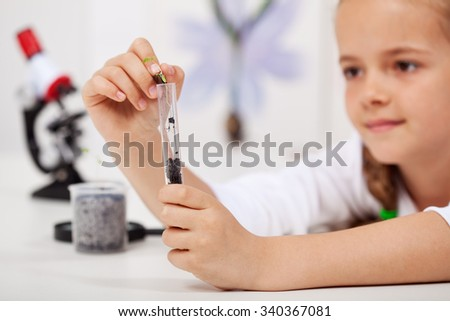 Young student in elementary school science class - study nature - stock photo