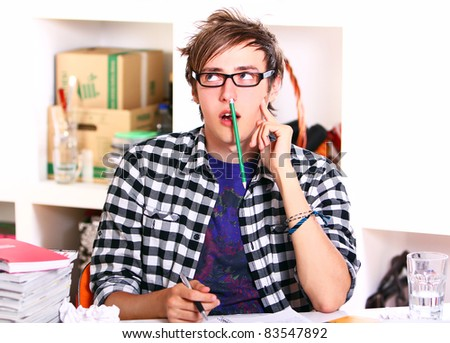 Young student in glasses think about something - stock photo