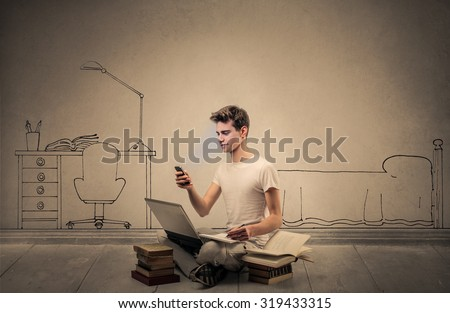 Young student in his bedroom - stock photo