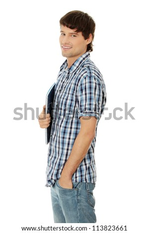 Young student man with notebook,isolated on a white background - stock photo