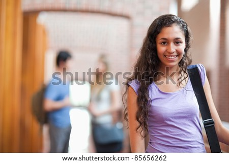 Young student posing in a corridor - stock photo