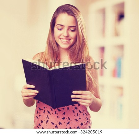 young student reading a book on white background - stock photo