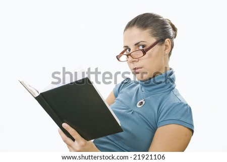 young student reading book for exam - stock photo
