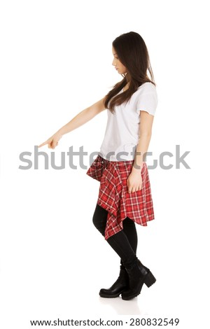 Young student rock woman pointing down. - stock photo