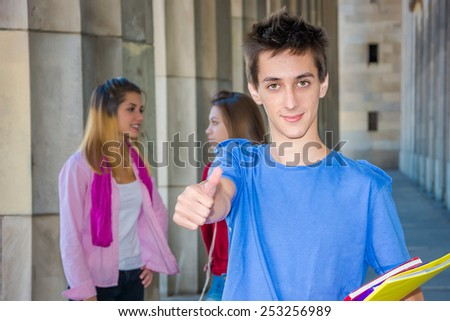 Young student showing thumb up - stock photo