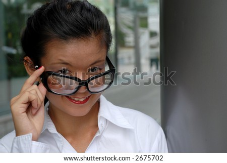 Young student smiling with glasses - stock photo