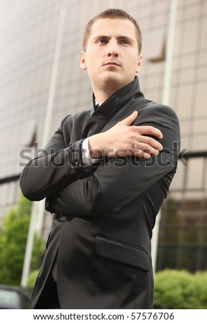 young student standing near  institute building - stock photo