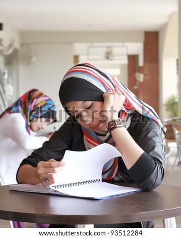 Young Student Studying at the Cafe - stock photo