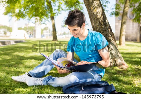 Young student studying at the school garden